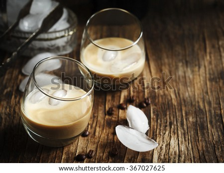 Irish creme liqueur in glass with ice. - stock photo