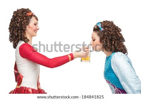 Irish dancers drinking beer - stock photo