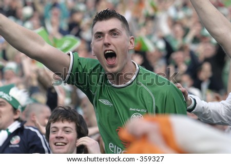 Irish fans celebrate after Ian Hartes' opening goal. Ireland V Israel,World Cup Qualifier, 04 June 2005,Lansdowne Road,Dublin. - stock photo