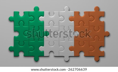 Irish flag assembled of puzzle pieces on gray background - stock photo
