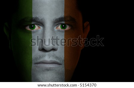 Irish flag painted/projected onto a man's face.