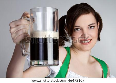 Irish Girl Holding Beer - stock photo