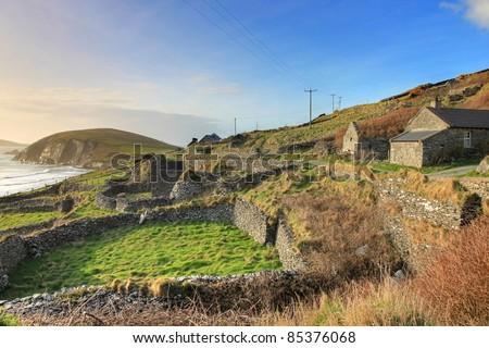 Irish landscape at sunset, buildings in dingle - Ireland. - stock photo