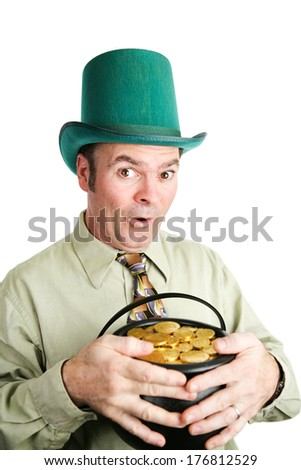 Irish leprechaun with his pot of gold, in celebration of St. Patrick's Day.  White background. - stock photo