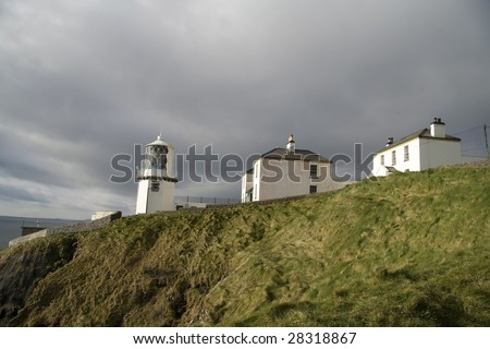 Irish lighthouse and houses