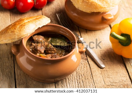 Irish pie with meat and vegetables on a wooden table