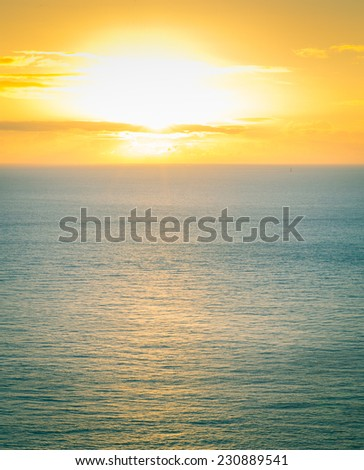 Irish sea at golden hour - stock photo