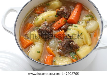 irish stew in enamel pot - stock photo