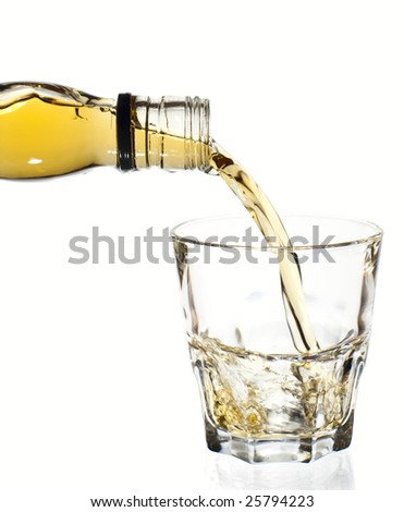 Irish whiskey is poured in tumbler glass, isolated, clipping path - stock photo