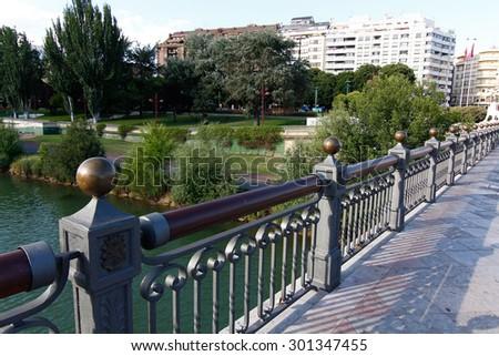 Iron and concrete bridge over a river - stock photo