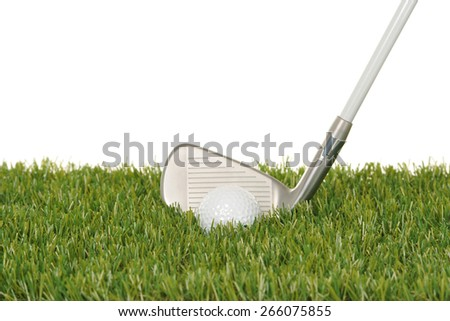 Iron and golf ball in grass - stock photo