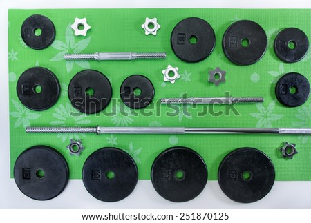 Iron and steel free weights set for fitness - stock photo