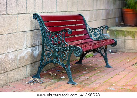 Iron And Wood Garden Bench Painted Green And Red, With Small Depth Of Field