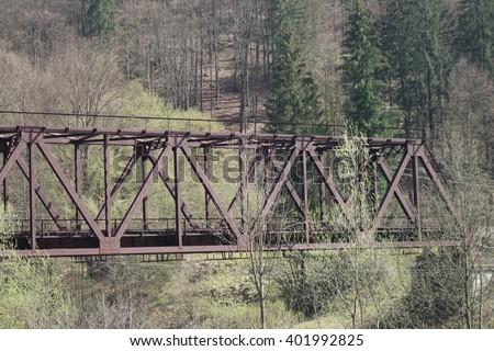 Iron bridge over the river - stock photo