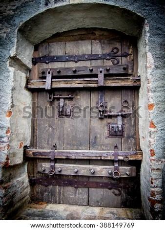 Iron buckle door with huge locks game of thrones style - stock photo