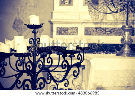 Iron candelabra in a church, artistic sepia edit with copy space for text
