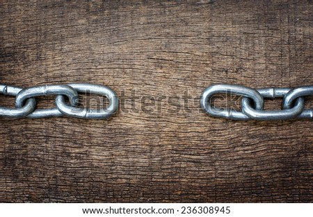 iron chains separately on the background wood texture to the theme - stock photo
