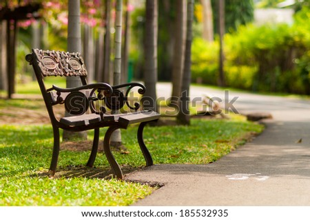 Iron chair in a green garden