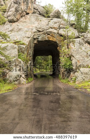 Iron Creek Tunnel / A narrow tunnel on a road.