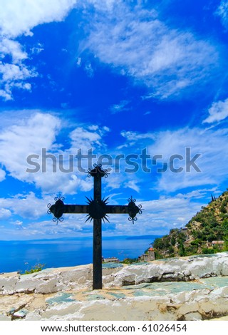 Iron cross against a blue sky on Mount Athos, Greece
