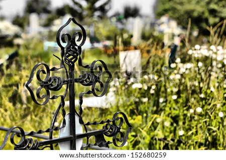 Iron Cross in the cemetery closeup - stock photo