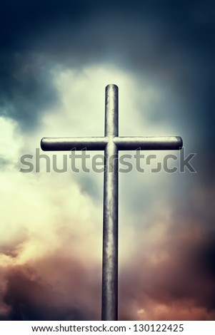 Iron cross on dark sky. Religion concepts - stock photo