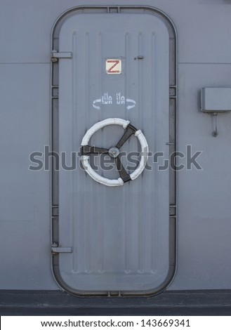 Iron door. Inside details from a warship - stock photo
