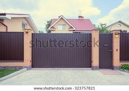 Iron gate of the luxury comfortable home.  - stock photo