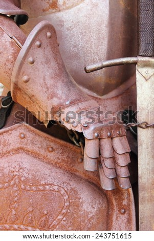 Iron gauntlet of a medieval armor - stock photo