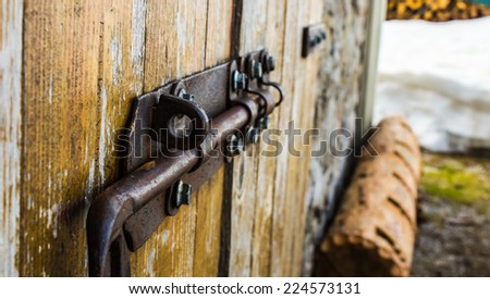 iron latch on an old wood door