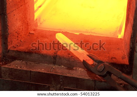 Iron lingot on 1000 C temperature in furnace - stock photo
