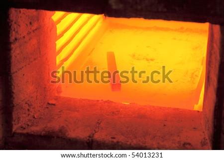 Iron lingot on 1000 C temperature in furnace - stock photo
