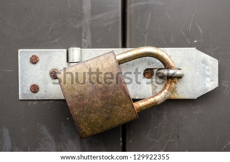 Iron lock and chain on an old door - stock photo