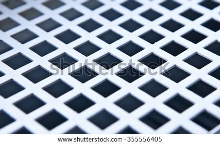 Iron metal ventilator grill closeup - stock photo