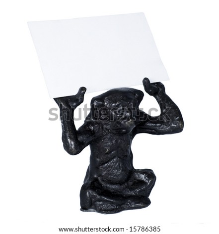 Iron monkey holding blank business card. - stock photo