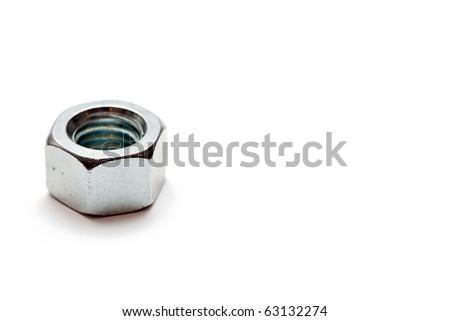 Iron nut isolated on white - stock photo