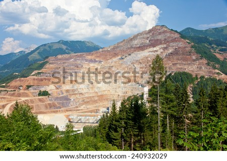 Iron ore open mine pit - stock photo