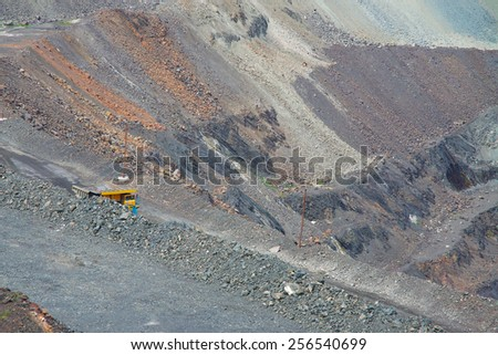Iron ore opencast mining - close up view of the pit - stock photo