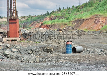 Iron ore opencast mining - details inside the pit - stock photo