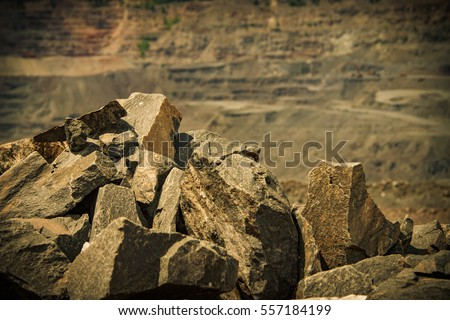 Iron ore opencast mining landscape lit with warm light