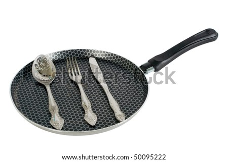 iron pan and steel utensil with  white background