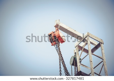 iron pulley on blue sky ,vintage - stock photo