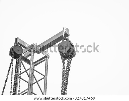 iron pulley on white background , black and white - stock photo