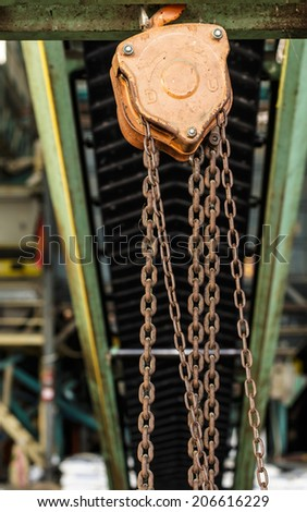 iron pulley use with conveyor in factory - stock photo