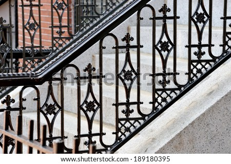 Iron railing and doorsteps, classic handrail and side panel design - stock photo