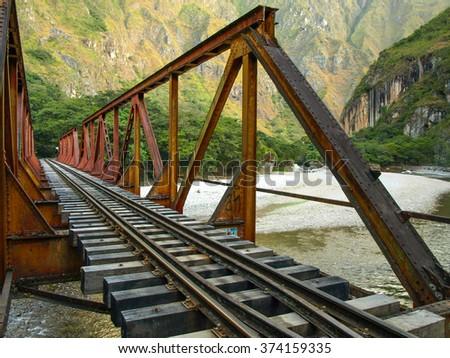 Iron railway bridge over Urubamba river near Machu Picchu - stock photo