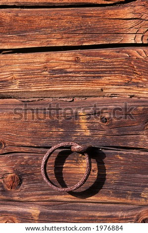 Iron ring on the wood wall - stock photo