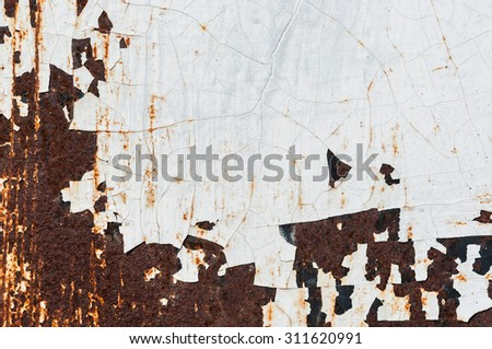 Iron rusty artistic wall peeling paint for background - stock photo