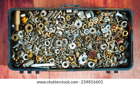 iron screw nuts in the box - stock photo