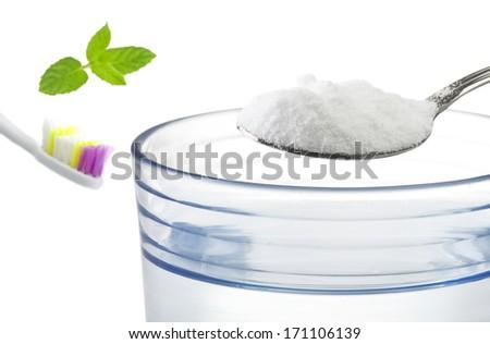 Iron spoon of baking soda close up  - stock photo